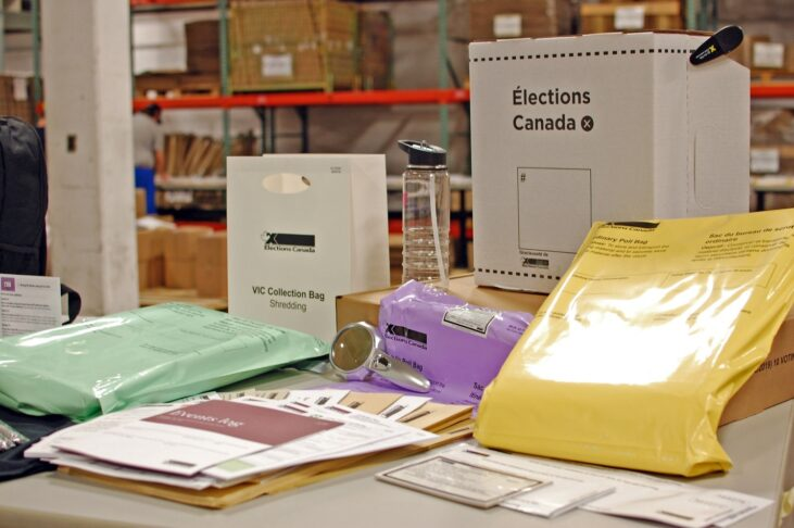 Image of a table with various print materials for Elections Canada